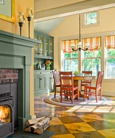 Soft greens, blues, yellows, red accents, and a reclaimed-barn-wood floor that has a checkerboard stain brighten this 1830's Farmhouse. | Photo: Jim Westphalen | thisoldhouse.com