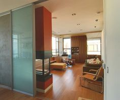 Glass doors and others by Build LLC: Elegant glass bypass doors by Raumplus allow flexibility and openness in interior spaces. Projects designed + built by BUILD LLC in Seattle, Washington.
