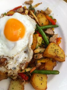 The most popular tyrolean food among the savoury dishes: Tiroler Gröstl - roast potatoes with beef, onions, bacon and a fried egg on top