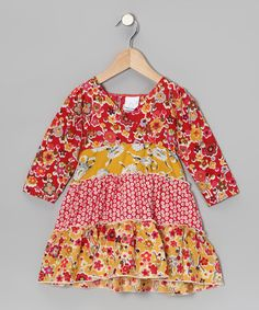 This playful dress showcases a selection of perfectly matched prints. Made of comfy cotton, it features cozy long sleeves, a stylish surplice neckline, a fun ruffle hem and a darling sash that ties in the back.100% cottonMachine wash; tumble dryMade in the USA