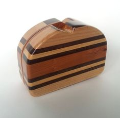 Just bought this wood clutch yesterday. I can't wait to get in the mail later on this week! So exciting!!! Segmented Brown Stripe Wood Clutch Purse