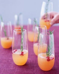 Sparkling Pear and Cranberry Cocktail - Cranberries, Pear Nectar, Moscato, Rosemary Sprigs.
