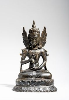 CROWNED BUDDHA WITH PITTANCE BOWL Catalog Number: AB916-395 Bronze Northern Thailand approx. 18th to 19th cent. HEIGHT 27,4 CM