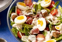 Turn the classic Caesar salad into a healthy, filling meal with slices of bacon, chicken, eggs and crunchy croutons.