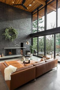 We are in LOVE with this midcentury modern living room! 😍 How awesome is the high ceiling, massive black brick fireplace and large windows? Industrial Interior Design, House Design, Mid Century Modern Living Room, Black Brick Fireplace, Interior Design Inspiration, Rustic Kitchen Design, Minimal Interior Design, Brick Fireplace, House Interior