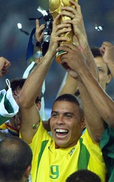 Brazilian forward Ronaldo holding the World Cup trophy won after his team defeated Germany 2-0 in the final match of ...