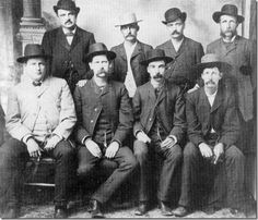 This is the Kansas Peace Commission in Dodge City. Some photos have the man in the back, far right, erased or cropped out. This is a very good copy of the original pic. Petillion is the last name, I think, of the man scrubbed from the photo sometimes. I've seen both. Wyatt Earp and Bat Mastersin are there. If you doubt anything I said, contact Boot Hill in Dodge City.