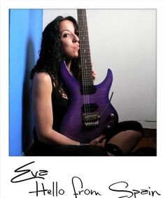 "Luna artist ""Eva"" with her purple Andromeda electric guitar."