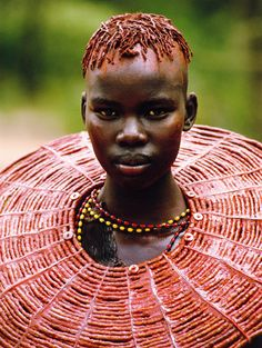 "Pokot Girl, Kenya  ""A young girl wears a necklace of beads cut from the stem of an asparagus tree."""