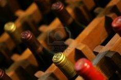 Bucharest, Romania - May 31, 2012: Wine bottles are displayed on shelves in a store in Bucharest, Romania.  Stock Photo