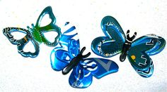 Recycled Soda Can Art  Butterfly Trio Magnets by apmemory on Etsy    I think that one could make a die cutter and cut these on some kind of foam to get the rolled edges then bend them for wall butterflies.