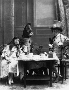 """The Mad Hatter's Tea Party from """"Alice in Wonderland"""" at the Opera Comique Theatre in London. Rosa Hersee plays Alice and Arthur Elliot is the Hatter. Vintage Photographs, Vintage Photos, Chesire Cat, Foto Poster, Creepy Photos, Mad Hatter Tea, Mad Hatters, The Hatter, Foto Art"""