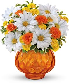 Telefloras Rise and Sunshine - summer flowers in an orange glass candle bowl
