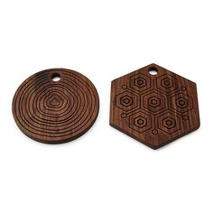 The richly grained, solid walnut board is smoothly finished on one side for an ideal cutting board surface, and sports incised, geometric patterns on the flipside to serve as a textured trivet.