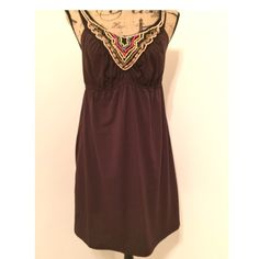 Chocolate Brown Dress Rich chocolate brown dress with adjustable straps.  Nice multi colored beading around the neckline.  Measures 27 inches from the top of the neckline. Polyester/rayon/spandex blend.  Super comfortable. Maurices Dresses Mini