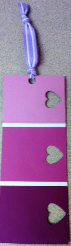 Purple paint swatch bookmarker by ShinyPlasticShop on Etsy, $2.50.....easy enough to make on your own!!!