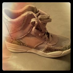 Skechers wedge sneaker Brand New wedge sneaker Gold, metallic snake skin sides wit leather bottom Skechers Shoes Athletic Shoes
