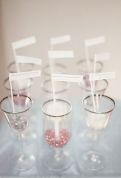 glitter in glasses as placecard holders