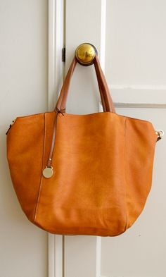 Great color for any season..BTW even better price.  (http://www.shopconversationpieces.com/day-cation-tote-pumpkin)