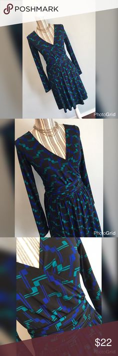 "NEW LISTING Geometric-pattern faux wrap dress by Moda International. Size Small. Bust 32"" lying flat, stretches to 38"". Waist 28"" lying flat, stretches to 34"". Shoulder to hem length 36.5"". Moda International Dresses Long Sleeve"