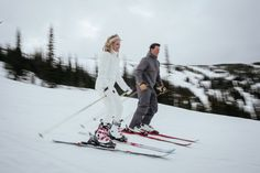 Matt Shumate Photography at Schweitzer Mountain Resort winter wedding panning motion blur of bride and groom skiing together after ceremony