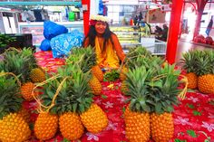 Pineapple and beautiful Tahitian at Papeete Market