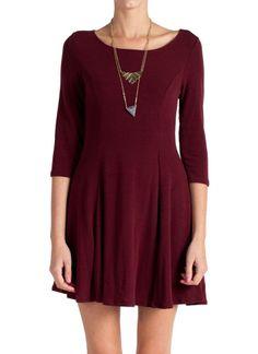 Burgundy skater dress with quarter length sleeves.