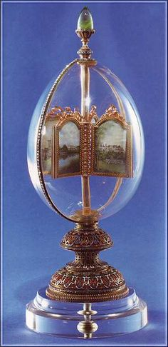 The 'Revolving Miniatures' Faberge Egg (aka the 'Rock Crystal' Egg) ~ made in 1896. The egg contains 12 miniatures scenes. The top features a 27 carat Siberian emerald ~ the biggest gem used in the Imperial Easter Eggs. This egg was sold in 1930, bought by Lillian Pratt (wife of a GM executive) in 1945.