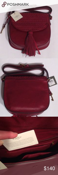 """Fossil Emi Tassle Leather Saddle Bag Purse  NWT Brand New with tags leather purse.  Inside has a zipper pocket on one side and an open open pouch on the other side.  Plenty of room on the inside!  Closes with a snap.  Shoulder strap is adjustable.  At the longest it is approx 51.5"""" from side to side and at shortest it is approx 46"""". Fossil Bags"""