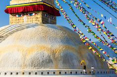 """""""Cleaning The Stupa"""". Custodians fling yellow colored water made from saffron onto Bodhnath Stupa in Nepal."""