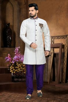Look trendy yet traditionally charming with this Off White Jacquard Sherwani.All patterns are intricately embellished with Bugle Beads Cutdana, Gold Zardosi & Patch Work work. Sherwani Groom, Mens Sherwani, Wedding Sherwani, Indian Wedding Clothes For Men, Indian Wedding Outfits, Indian Outfits, Traditional Indian Mens Clothing, Kurta Pajama Men, Indian Bridal Fashion