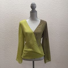 """Chelsea & Violet Sz M Polka Dot Wrap Top Loose Fit Brand: Chelsea & Violet from Dillard's   • Type: Semi-sheer, polka dot, faux wrap, 3/4 sleeve (roll-tab) blouse • Size: Medium  • Fabric: Polyester • Condition: Excellent used condition • Color: Brown and darker yellow with green undertone • Measurements: Bust – 20"""" across the front, lying flat. Length – 24.25"""" from shoulder to hem. Chelsea & Violet Tops Blouses"""