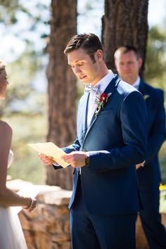 Jon confidently wears the Fixie Bike Bow Tie while reading vows