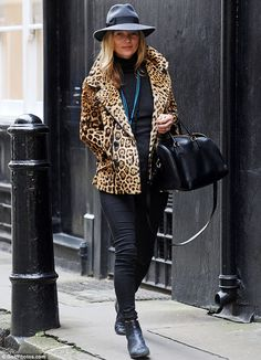 Positively purr-fect: Kate Moss showed off her supermodel credentials in a double-breasted leopardprint jacket as she stepped out in London on Wednesday