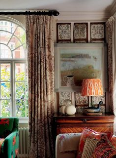 Kit Kemp. Robert Kime fabric made into curtains sits alongside a painting by Caroline McAdam Clark, which is set against strips of old panels that I liked simply for their aged patina and pattern