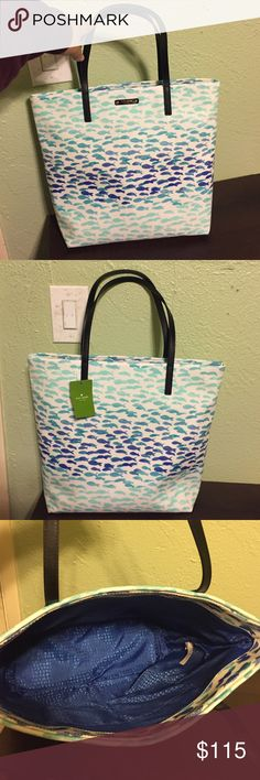 """NWT Kate spade bon shopper tote NWT Kate spade bon shopper tote with fishies all over it! This would be perfect for the beach and all of your vacations. It has two pockets on the inside big enough to fit a passport each. Approximately 14"""" H 13.5 W and 5"""" W. No trades. kate spade Bags Totes"""