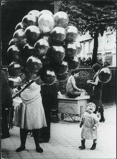 A balloon! Look how happy he is.  Luna Park Paris, 1910.
