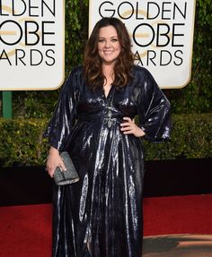 Golden Globes Red Carpet 2016 Melissa McCarthy in a black metallic dress she designed herself, with a silver clutch, Kimberly Mcdonald jewelry, and black strappy heels.