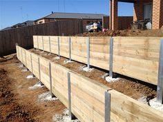 Barwon Landscapes Pty Ltd - Services Backyard Retaining Walls, Building A Retaining Wall, Garden Retaining Wall, Sloped Backyard, Cozy Backyard, Backyard Landscaping, Lake Cabins, Wood Stone, Construction