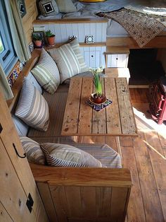 Something like this could go where the couch is. Fold down table. Wanting to eventually replace couch anyway.
