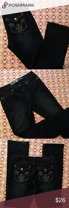 """Boot cut jeans Ethyl classic size 14  boot cut jeans with detail stitched back pockets and rhinestones and slight factory fade at thighs. 4 larger stones in corners of front pockets. Full rise so you don't have to worry if your underwear is showing when you bend over 😉! Lightweight denim but not thin like jeggings. Worn maybe 3 times. They are a VERY dark blue/black so it looks good with either color top. Very flattering 😊 Waist 17"""" Inseam 34"""" Rise 11"""" Leg opening 9"""" 70% Cotton 29%…"""