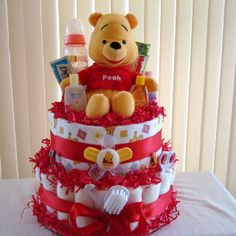 This Pooh Diaper Cake includes:  60 Pampers Swaddlers size 1 Travel size baby lotion, shampoo, powder, head-to-toe wash, Desitin, and soothing lotion. 1 pacifier & clip 1 comb & brush set 1 medicine dropper 1 nose aspirator 1 rec. blanket 2 bottles 1 travel size pack of wipes   Topped with Winnie Pooh  Matching Ribbon and Embellishment  I can make custom Diaper Cakes, just let me know what theme or color you want.