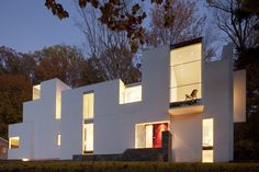 The NaCl House by David Jameson Architect in Bethesda, Maryland, USA - Tetris-like white exterior that resembles a natural formation of mineral rock salt, hence its name.