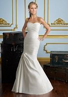 Luxe taffeta and corset back make this a perfect destination wedding dress for $399 little dollars. Mori Lee.