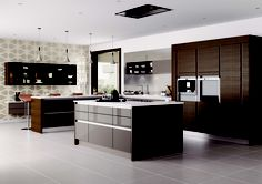 White quartz worktops are the perfect contrast for dark kitchens