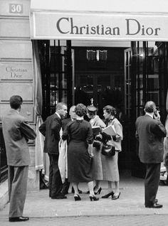 'Reporters waiting outside of the Christian Dior 30 Avenue Montaigne boutique in anticipation of the designers next collection - August, 1953'