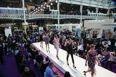 The models come together and, as a group, walk the catwalk all together in a linear format at the end of the scene. Fiercely taking on the runway, the models showcase the womenswear fashion apparel and accessories on offer from the collections featured at Pure London AW17/18 by exhibiting brands and designers. Olympia London, Aw17, Exclusive Collection, Catwalk, February, 18th, Designers, Women Wear, Runway