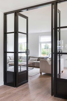 Loving interior windows and doors these days. What a great way to close off some private space while still having light throughout your house. Interior Windows, Interior Barn Doors, Exterior Doors, House Doors, Door Design, Home Living Room, Windows And Doors, French Doors, New Homes