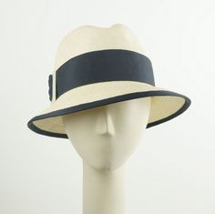 This is a classic fedora hat for women that is one-of-a-kind and completely handmade by me. Its the perfect vintage style casual hat for daytime and will keep you protected from the sun in style. This hat is a high end accessory and very different from the cheap hat you buy in the mall.  Made of natural Panama straw trimmed with dark blue grosgrain ribbon. Wired brim edge.  Size 22, fits average size heads. Unlined.   °º©©º°¨¨¨¨¨¨°º©©º°¨¨¨¨¨¨°º©©º°¨¨¨¨¨¨°°º©©º°  More hats here…