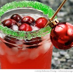 Christmas cranberry margaritas: Yield: 4 servings   1/2 CUP CRANBERRY JUICE OR CRANBERRY JUICE COCKTAIL  1/2 CUP SILVER OR OTHER 100% AGAVE TEQUILA  1/4 CUP ORANGE LIQUEUR (GRAND MARNIER, TRIPLE SEC OR CITRONAGE)  1/4 CUP FRESH LIME JUICE GARNISHES: THINLY SLICED LIMES OR FRESH CRANBERRIES